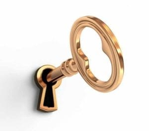 Gold key in a keyhole