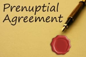 "Yellow paper with the words ""Prenuptial Agreement,"" along with a fountain pen and a red seal."