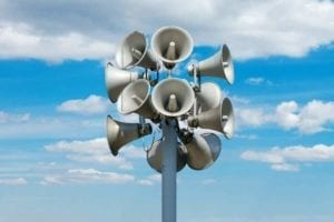 Speakers mounted on a pole