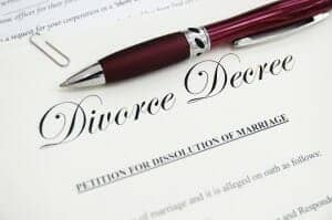 Divorce Decree with a pen on it.