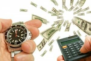One hand holding a watch, one hand holding a calculator and money flying