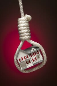 Toy house hanging in a noose: keeping the house in a divorce isn't always good.