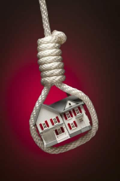 Noose with a toy house in the middle of it.