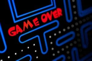 "Close up of pac man arcade game on the red words ""Game Over."""