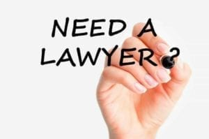 "Hand writing on a clear board, "" Need a Lawyer?"""