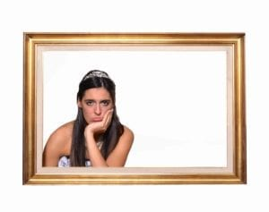 Sad bride in an empty picture frame.