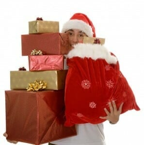 Man carrying Christmas gifts