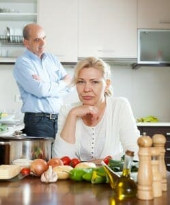 Upset older couple in kitchen getting a divorce over 50