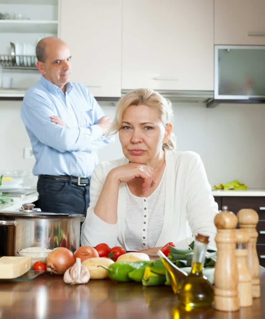 Senior mature couple conflicted at home kitchen