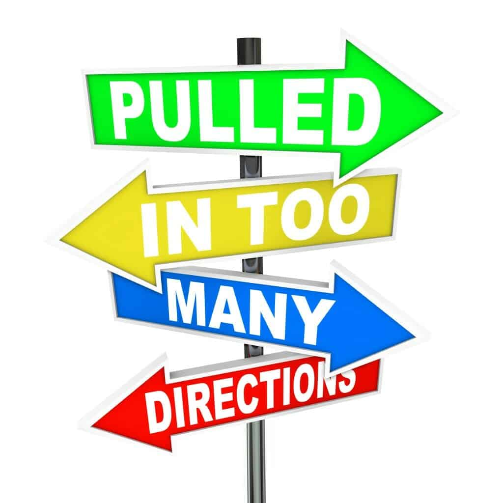 """Sign with arrows pointing different directions saying, """"Pulled in too many directions."""""""
