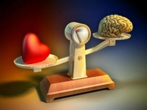 Illustration of a heart and a brain on a scale