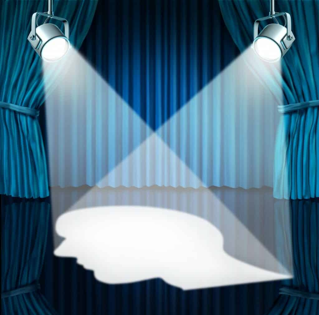 Spotlights on stage forming a picture of a white head.
