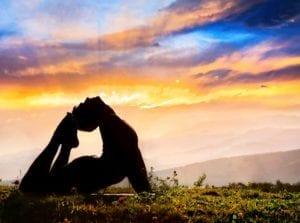 Divorce and Yoga: Man doing yoga at Sunrise