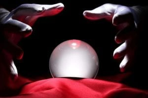 Hands hover over a Crystal Ball: To Stay Married or Get Divorced? That is the question.