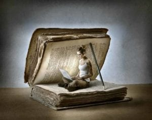 Young woman reading divorce books on a laptop inside of a giant book held open by a pencil.