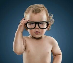 Cute little nerd boy wearing glasses isolation on blue background