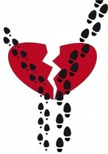 Heart broken in two halves, with man's and woman's footsteps walking through it and going in different directions