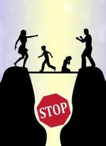 """Cartoon silhouette of mom and dad fighting on opposite hills, with their children on a board over the chasm between them and a sign saying """"Stop"""""""