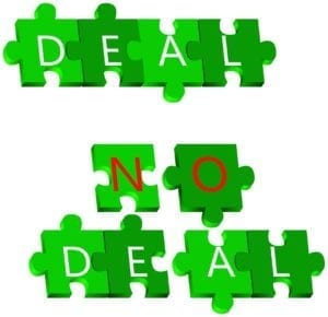 "Green puzzle pieces with letters on them that spell ""Deal No Deal"""