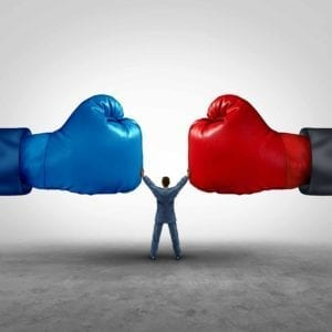 Divorce Mediation Image: Giant Red and Blue Boxing Gloves face off, with a small man in the middle, holding them apart.