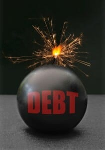 """Lighted time bomb with the word """"Debt"""" on it in red letters."""