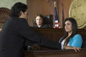 Courtroom scene where female witness testifies while a lawyer questions her and a judge looks on.