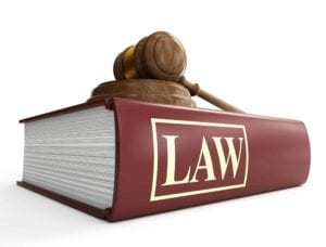 Law book with a judge's gavel on top of it