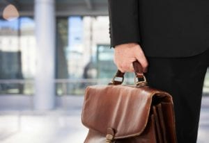 Close up of an old briefcase being carried by a lawyer.