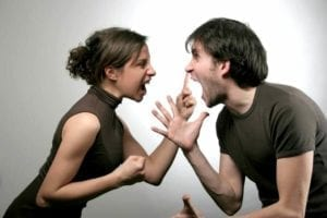 Young couple screaming in each other's faces.