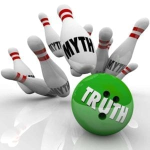 "Bowling pins with the word ""Myth"" on them being knocked down by a green bowling ball with the word ""Truth"" on it."