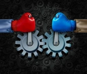 Red and blue boxing gloves holding gears steady - make peace