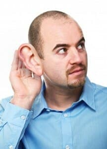 Man with hand next to his oversized ear - listening