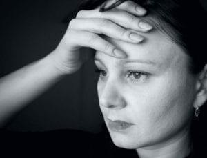 "Depressed woman holding her head, thinking, ""I don't want to get divorced."""