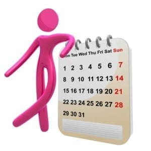 Pink figure next to a giant calendar.