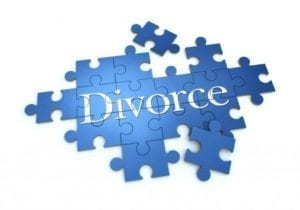 "Blue puzzle pieces with the word ""Divorce"" on them. The puzzle of no fault divorce."