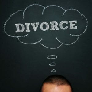 I want a divorce! A man over chalkboard with a thought bubble drawn in it and the word divorce