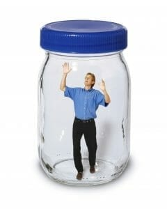 Stuck in an unhappy marriage: Small man trapped in a big mason jar.