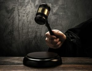 Close up of a divorce judge's hand banging a gavel in a DIY divorce.