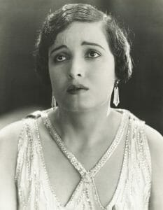 Vintage photo of woman in the 20's filled with self-pity. Eternal victim of divorce.