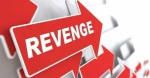 "The word ""Revenge"" on a red arrow. Many red arrows point the way."