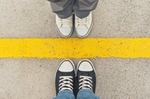 Sneakers at yellow line - Divorce tip: set boundaries with your spouse