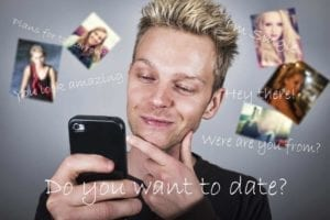 Dating during divorce - Man watching cell phone with women's pictures floating around his head and caption: Do you want to date?