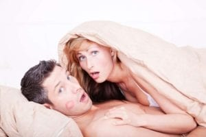 Adultery - Surprised man and woman caught in bed together