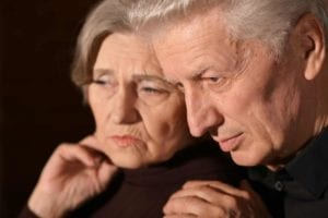 Close up of older couple contemplating divorce after 50