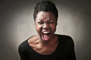 Angry African American woman screaming. Angry wife.