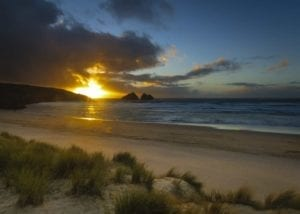 A dramatic sunrise at Holywell bay cornwall