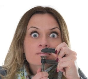 "Woman holding a clamp over her lips"" don't give too much information."