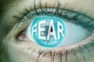 "Close up of eyeball with the word ""Fear"" on it: Fear of Divorce"