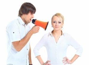 Man with a megaphone shouting in a woman's ear. How to tell your spouse that you want a divorce.