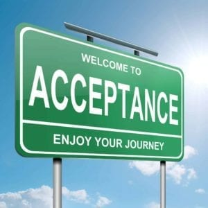 "Green road sign that says ""Welcome to Acceptance, Enjoy the Journey"""